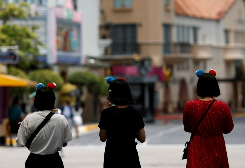 FILE PHOTO: People visit the largely empty Universal Studios Singapore, as tourism takes a decline following the coronavirus outbreak, in Sentosa