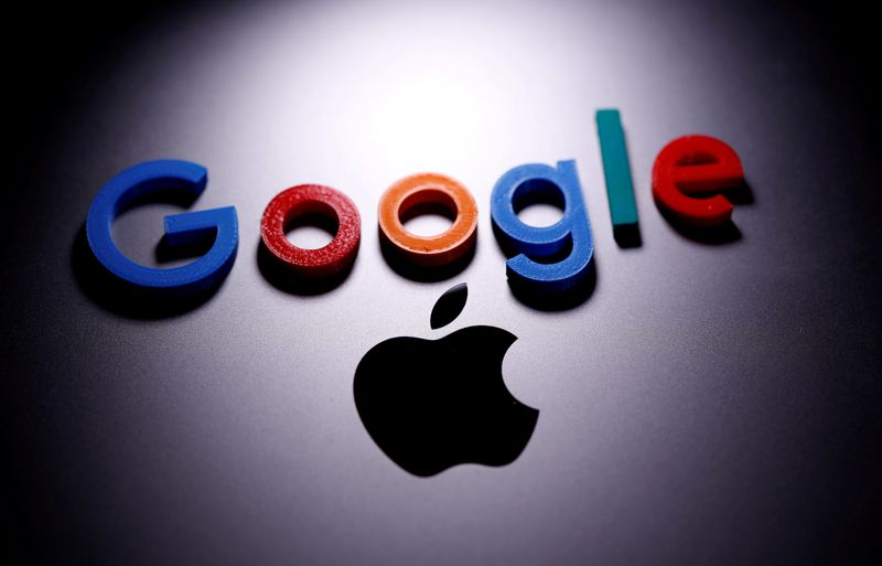 FILE PHOTO: A 3D printed Google logo is placed on the Apple Macbook in this illustration