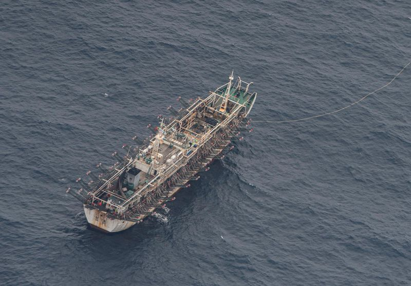 A fishing boat is seen from an aircraft of the Ecuadorian navy after a fishing fleet of mostly Chinese-flagged ships was detected in an international corridor that borders the Galapagos Islands' exclusive economic zone, in the Pacific Ocean