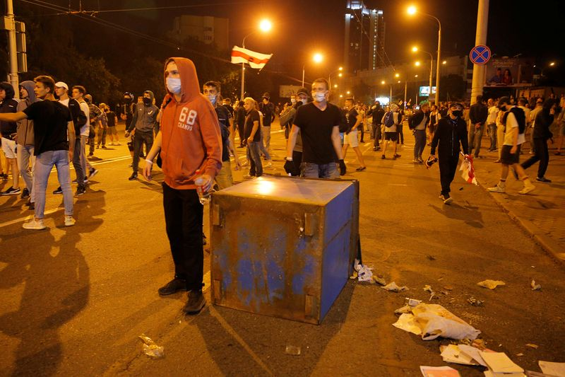 Clashes with opposition supporters after polls closed at the presidential election in Minsk