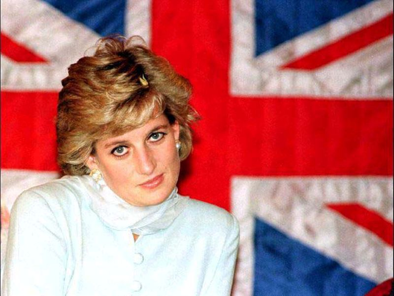 FILE PHOTO: FILE PHOTO OF THE PRINCES OF WALES SITTING IN FRONT OF A BRITISH FLAG