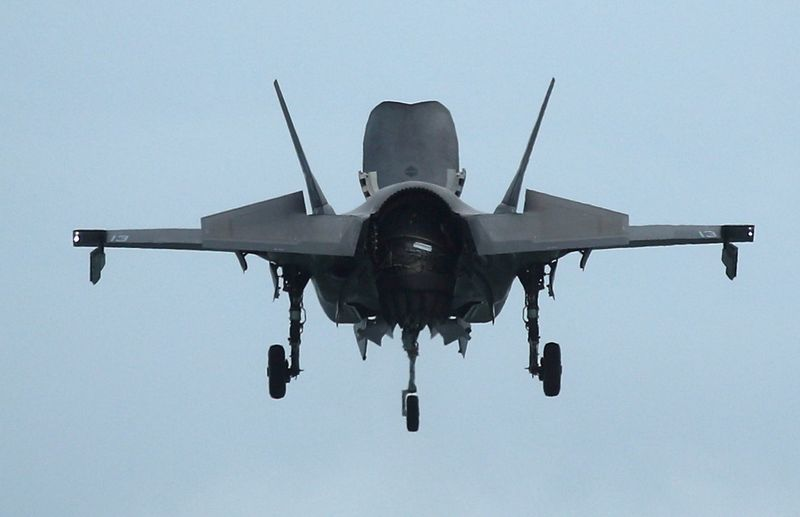 FILE PHOTO: A U.S. Marine Corps F-35B Joint Strike Fighter hovers in an aerial display during a media preview of the Singapore Airshow in Singapore