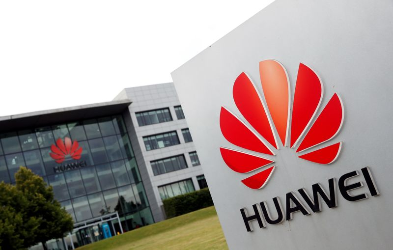 FILE PHOTO: Huawei logo pictured outside its headquarters building in Reading, Britain