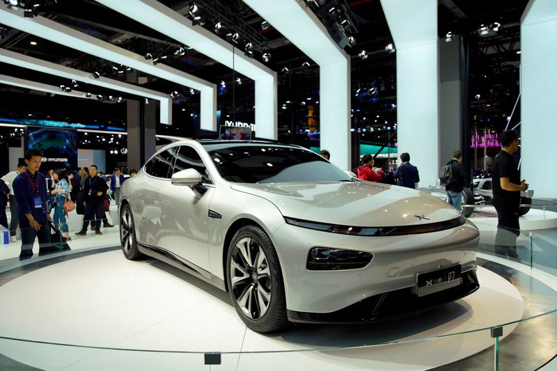 FILE PHOTO: XPeng's electric vehicle (EV) P7 is unveiled during the media day for the Shanghai auto show