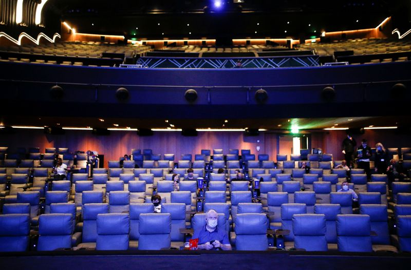 People take their seats inside the Odeon Luxe Leicester Square cinema, on the opening day of the film