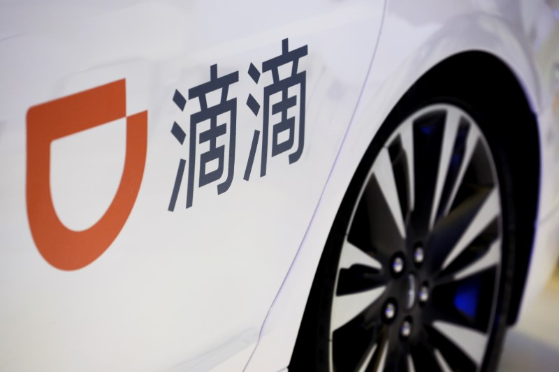 FILE PHOTO: The company logo of the Didi ride-hailing app on a car door at the IEEV New Energy Vehicles Exhibition in Beijing
