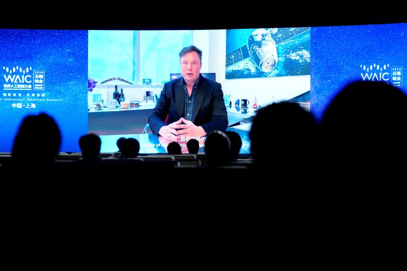 FILE PHOTO: Tesla Inc CEO Elon Musk is seen on a screen during the opening ceremony of the WAIC in Shanghai