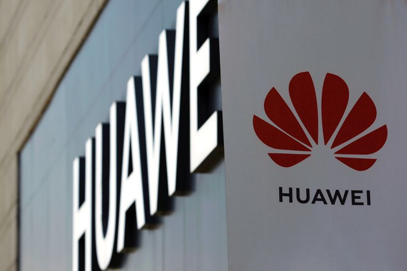 FILE PHOTO: Huawei sign is seen outside its store at a shopping complex in Beijing
