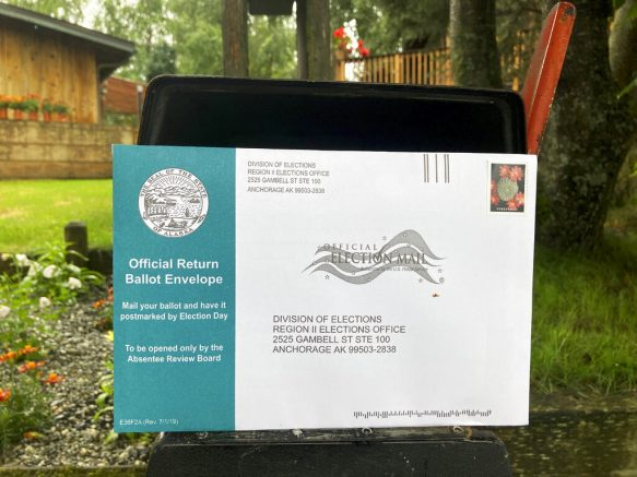 U.S. Postal Service to pause changes after mail-in voting outcry