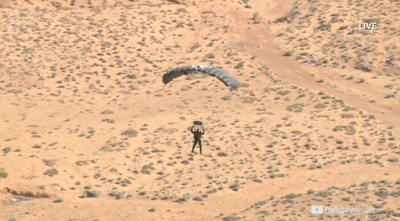 Extreme performer Blaine approaches a landing wearing a parachute over Arizona