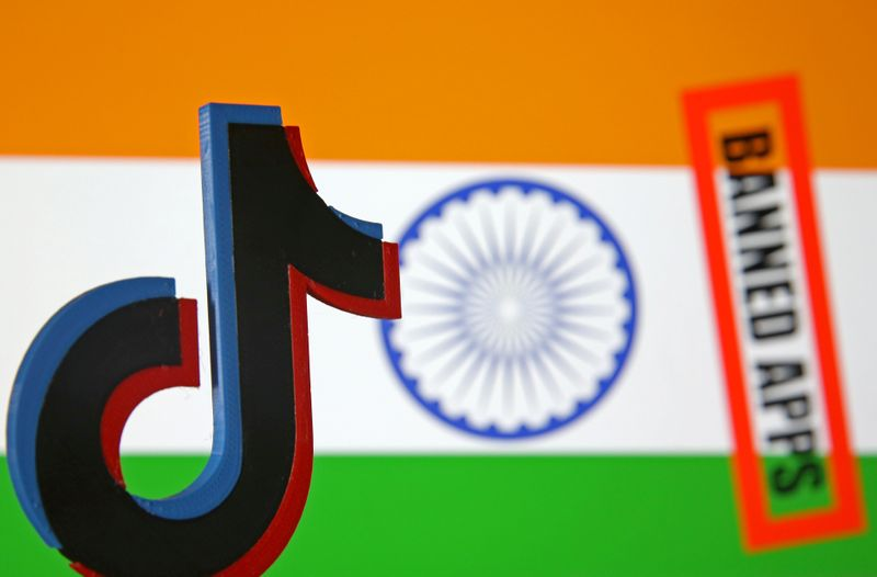 FILE PHOTO: A 3d printed Tik Tok logo is seen in front of a displayed Indian flag and a