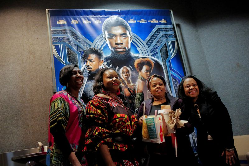 FILE PHOTO: A group of women pose for a photo in front of a poster advertising the film