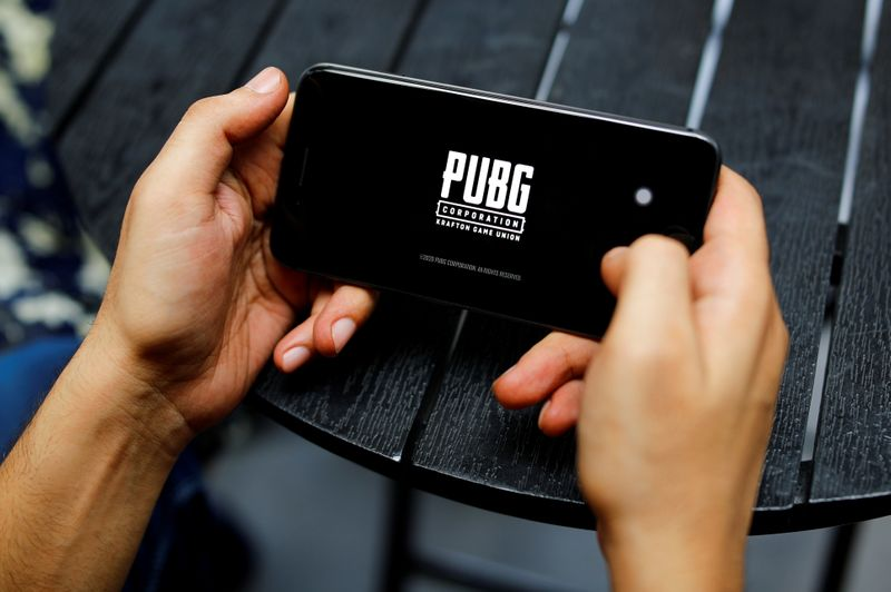 FILE PHOTO: A boy plays Tencent Holdings' PUBG videogame on his mobile phone at a cafe in New Delhi