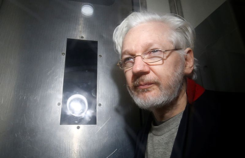 Julian Assange extradition hearing paused over COVID-19 risk