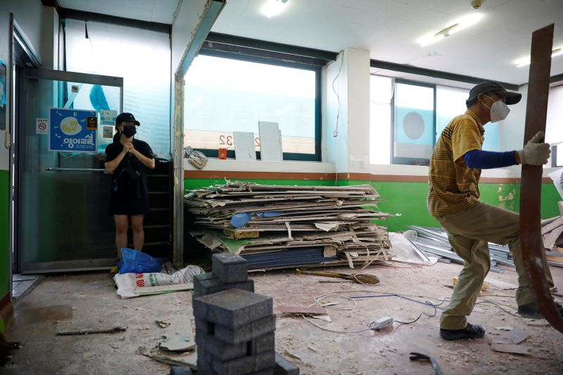 Kim Da-eun who used to run a private institute, takes photographs of her private institute that is currently torn down in Anseong