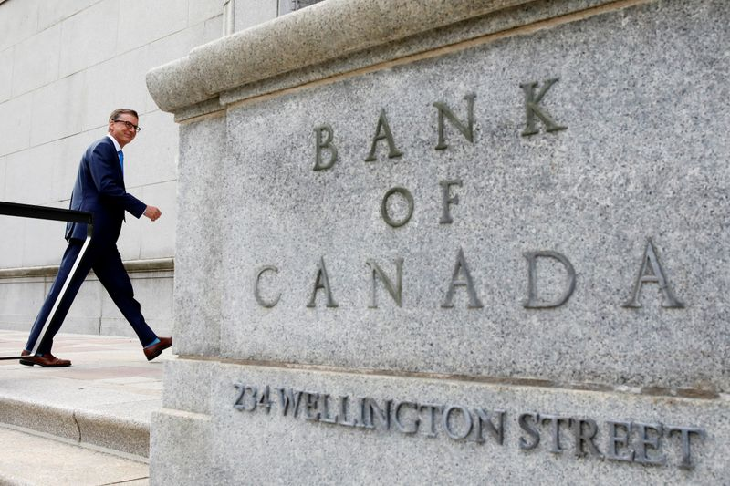 FILE PHOTO: Governor of the Bank of Canada Tiff Macklem walks outside the Bank of Canada building in Ottawa