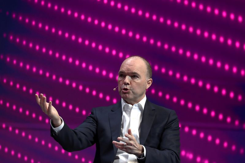 FILE PHOTO: Nick Read, CEO of Vodafone, gestures as he speaks during the Mobile World Congress in Barcelona