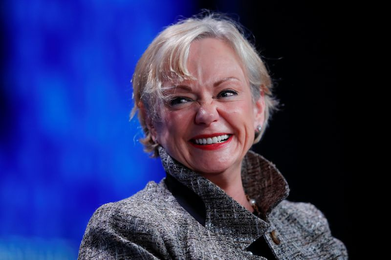 Christine McCarthy, Senior Executive Vice President and Chief Financial Officer, The Walt Disney Company smiles as she speaks during the Milken Institute's 22nd annual Global Conference in Beverly Hills