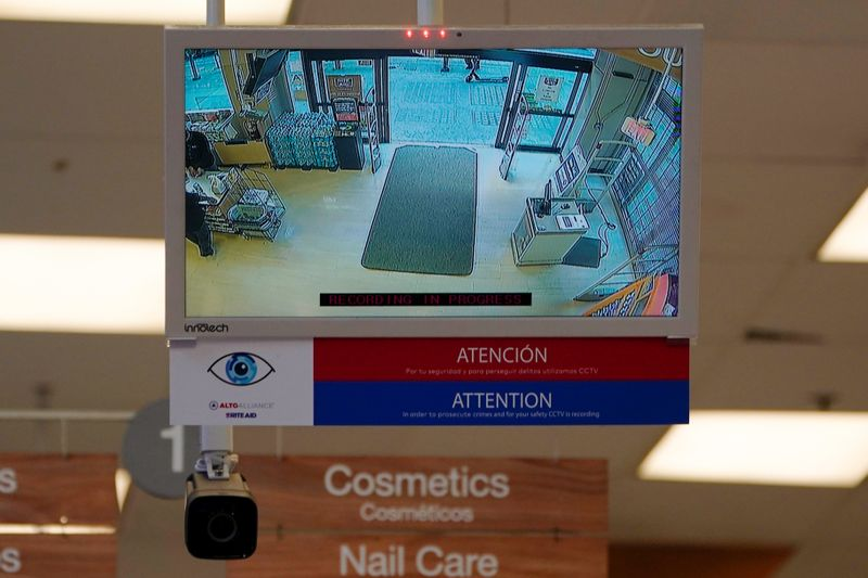 A facial recognition camera is shown pointed at the entrance of a Rite Aid store in downtown Los Angeles