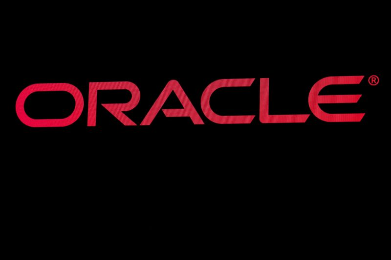 The company logo for Oracle Corp. is displayed on a screen on the floor at the NYSE in New York