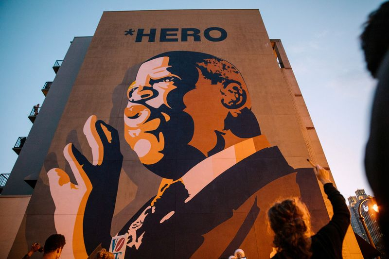 Mourners of the late Rep. John Lewis hold a vigil in his memory in Atlanta