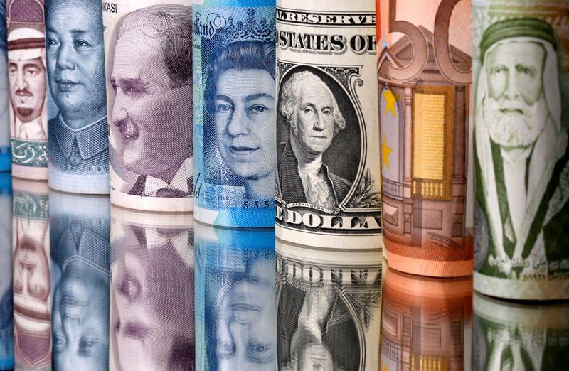 Saudi riyal, yuan, Turkish lira, pound, U.S. dollar, euro and Jordanian dinar banknotes are seen in this illustration