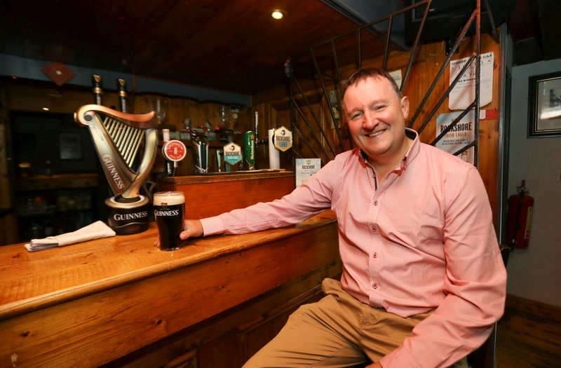 Publican Paul Moynihan prepares for reopening his pub in Donard, County Wicklow, Ireland