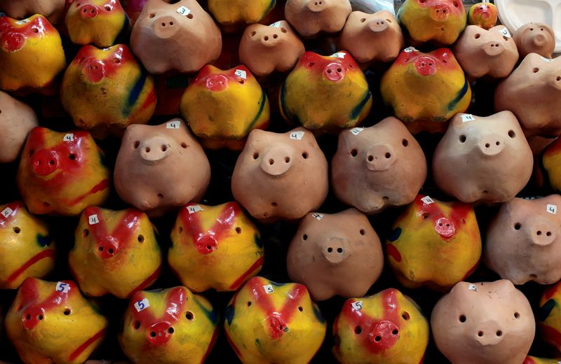 FILE PHOTO: Clay piggy banks are displayed in a store in the Central Market in San Jose
