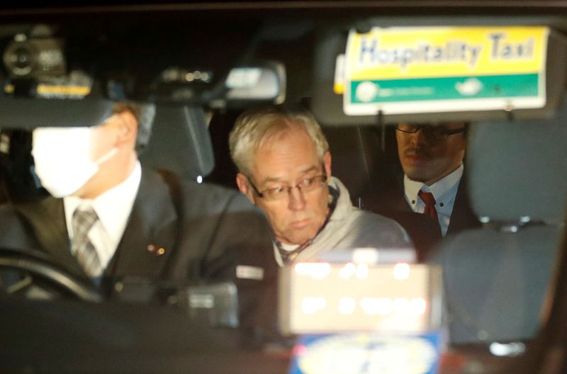 FILE PHOTO - Greg Kelly, the former deputy of ousted Nissan chairman Carlos Ghosn, is seen in the car, as he leaves after being released from a detention centre in Tokyo