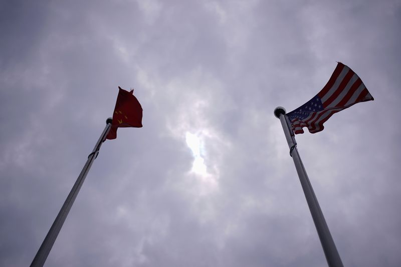 FILE PHOTO: Chinese and U.S. flags flutter in Shanghai