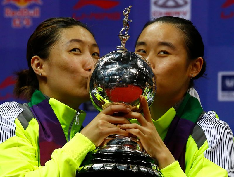 FILE PHOTO: China's Zhao and Wang kiss their trophy after winning their women's doubles final match against Japan's Maeda and Kakiiwa in the Uber Cup badminton championship in New Delhi
