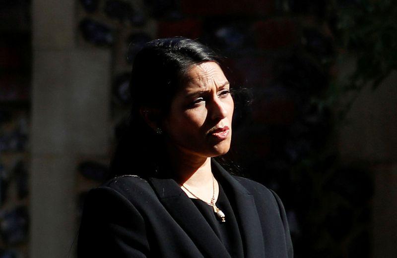 FILE PHOTO: Britain's Home Secretary, Priti Patel, speaks to the media in Reading