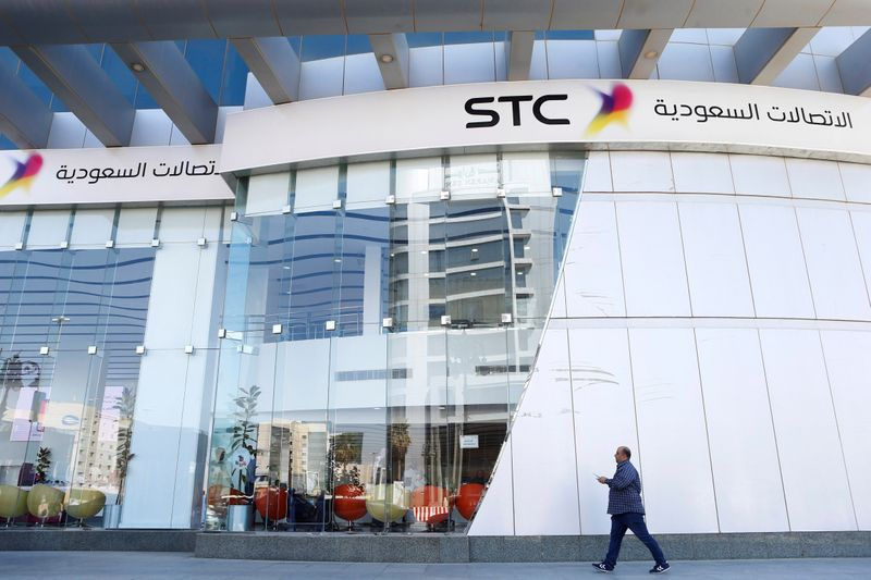 A man passes the Saudi Telecom STC office in Riyadh