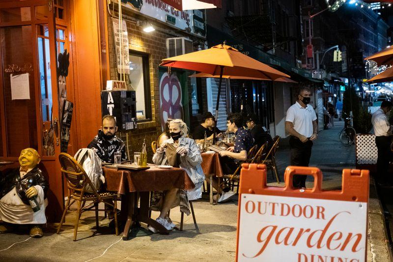 People enjoy outdoor dining amid the coronavirus disease (COVID-19) outbreak in Manhattan