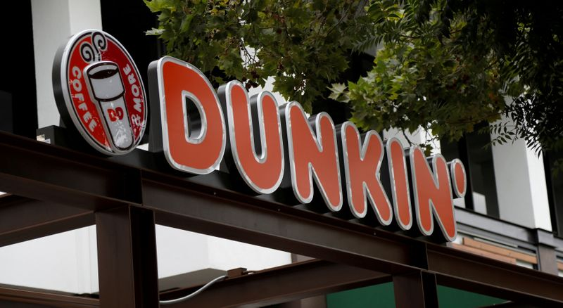 FILE PHOTO: The sign of a Dunkin' store, the first since a rebranding by the Dunkin' Donuts chain, is pictured ahead of its opening in Pasadena