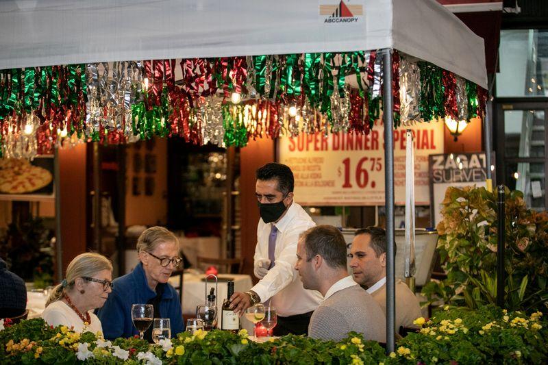 FILE PHOTO: People enjoy outdoor dining amid the coronavirus disease (COVID-19) outbreak in Manhattan
