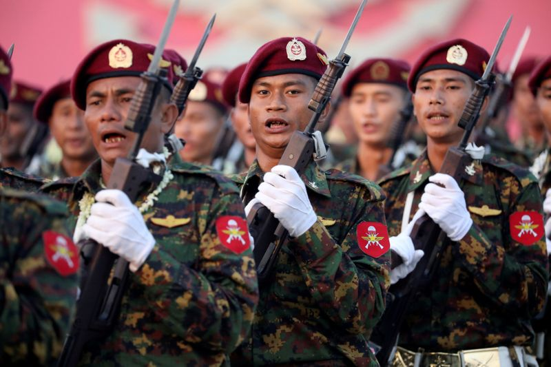 FILE PHOTO: Soldiers take part in a military parade to mark the 74th Armed Forces Day in the capital Naypyitaw