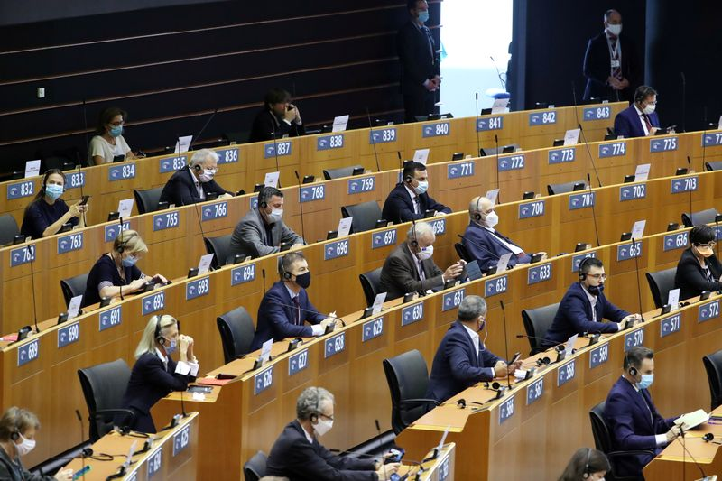 FILE PHOTO: Members of the European Parliament wait  for the start of a plenary session in Brussels