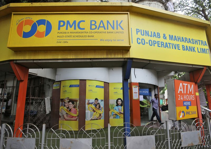 FILE PHOTO: A man walks out from a Punjab and Maharashtra Co-operative Bank branch in Mumbai