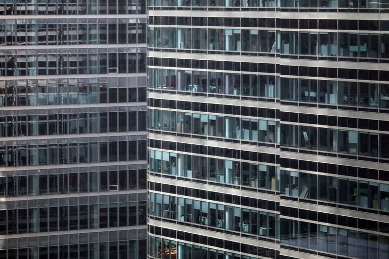S&P office is seen at right in Canary Wharf in London