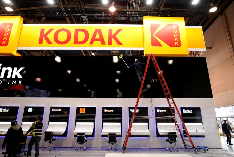 A worker cleans a Kodak booth at the Las Vegas Convention Center in preparation for 2019 CES in Las Vegas