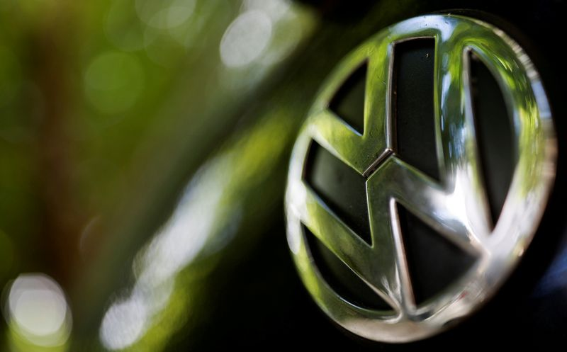 FILE PHOTO: A logo of German carmaker Volkswagen is seen on a car parked on a street in Paris