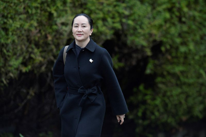 FILE PHOTO: Huawei CFO Meng leaves her home to attend her extradition hearing in Vancouver
