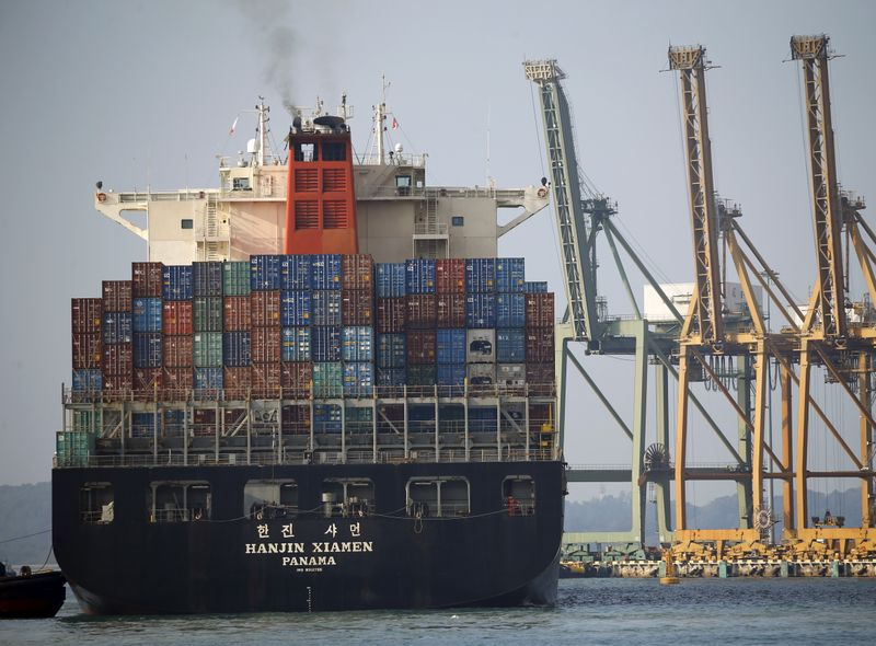 A ship prepares to dock at PSA's Tanjong Pagar container port in Singapore