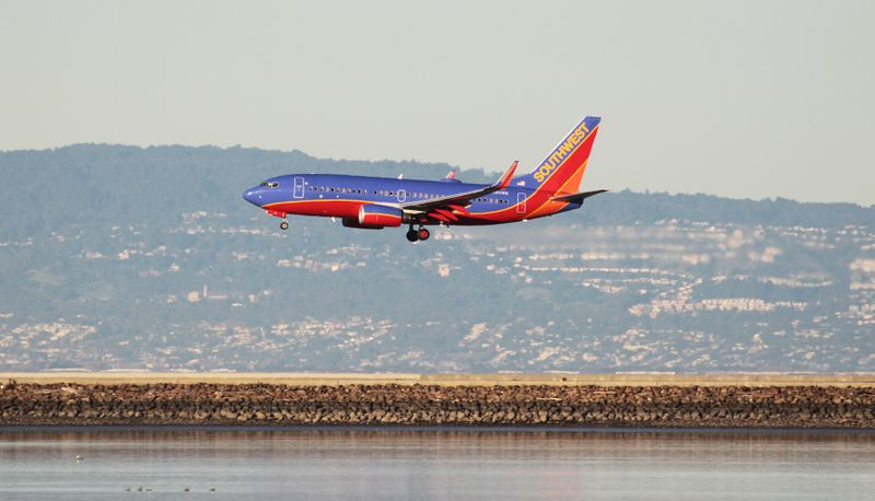 FILE PHOTO: A Southwest Airlines Boeing 737-800 lands at San Francisco International Airport, San Francisco