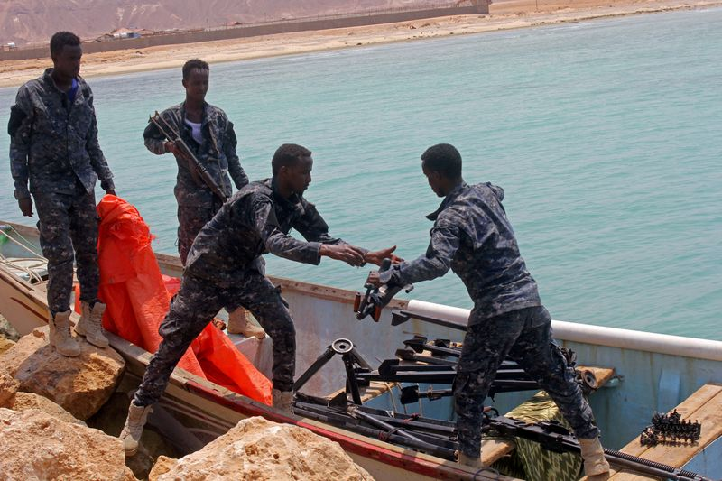 FILE PHOTO: Somali Puntland forces receive weapons seized in a boat on the shores of the Gulf of Aden in the city of Bosasso