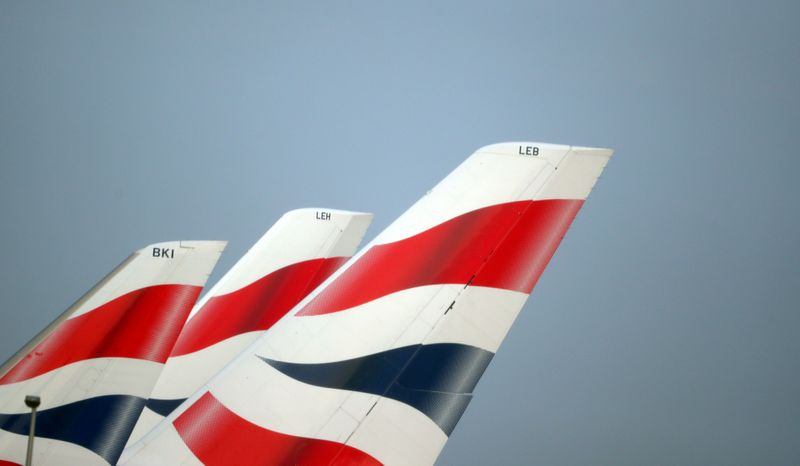 FILE PHOTO: FILE PHOTO: British Airways logos are seen on tail fins at Heathrow Airport in west London