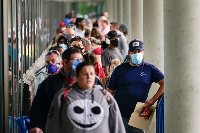 Hundreds of people line up outside a Kentucky Career Center hoping to find assistance with their unemployment claim in Frankfort