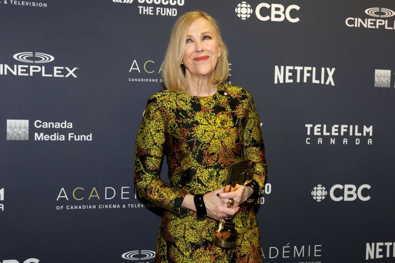FILE PHOTO: Catherine O'Hara poses backstage with the award for best actress in a comedy at the 7th annual Canadian Screen Awards in Toronto, Canada