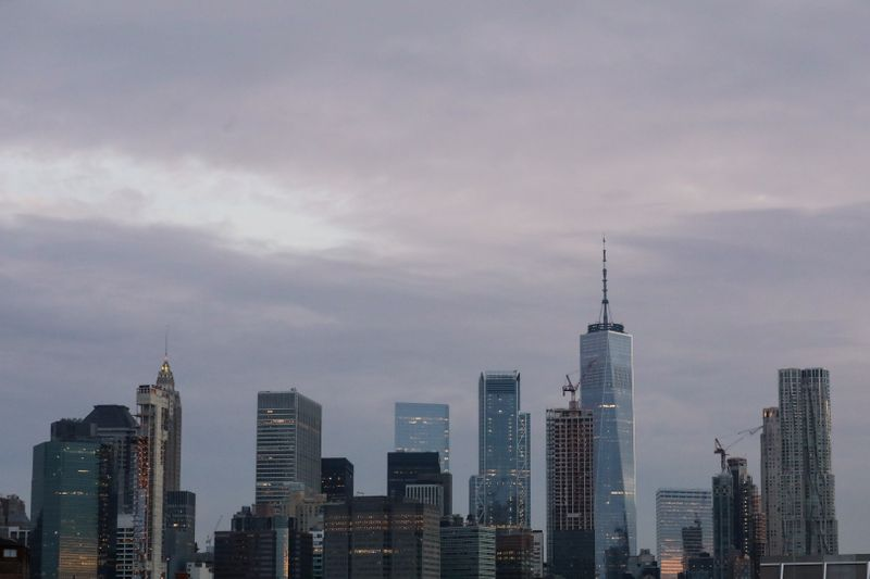 FILE PHOTO:  The skyline of lower Manhattan is seen before sunrise in New York